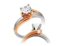 Bevilles 0.45ct Solitaire Swirl Shoulder Diamond Ring in 14ct White and Rose Gold